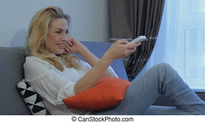 Woman approves watching TV at home