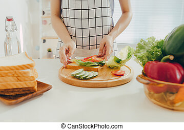 Woman apron preparing a breakfast in the kitchen