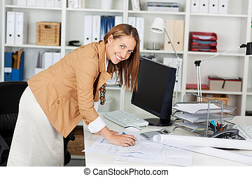 Woman Architect At Her Work Table