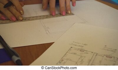 Woman architect drawing sketch. Hands and plan - Woman...