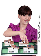 Woman architect showing a model