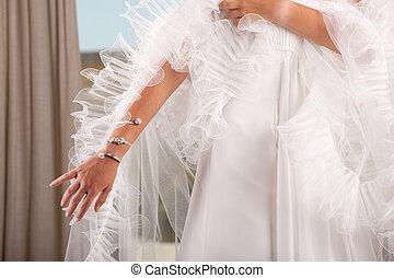 woman arm with bracelet