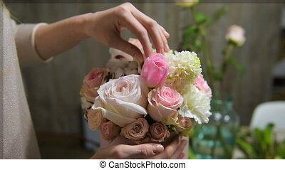 Tender female fingers touch beautiful bouquet - Woman...