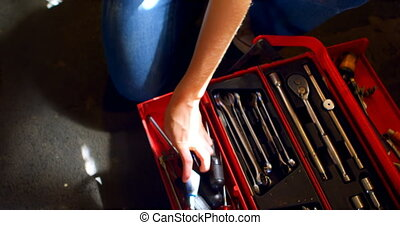 Woman arranging tools in tool box 4k - Woman arranging tools...