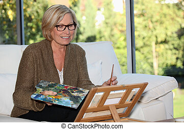 Woman artist at home