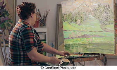 Woman artist painting picture and take a photo on smartphone