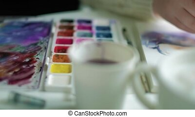 Woman artist painting watercolor paints 4k - Woman artist...