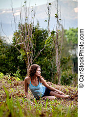 Woman as a part of tree in a jungle forest