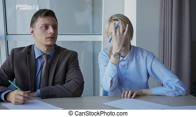 Woman asks man next to what is indicated in distance during...