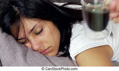 Woman asleep being wake up with cof