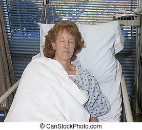woman asleep in hospital