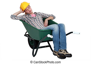 Woman asleep in wheelbarrow
