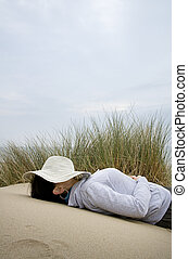 woman asleep on beach