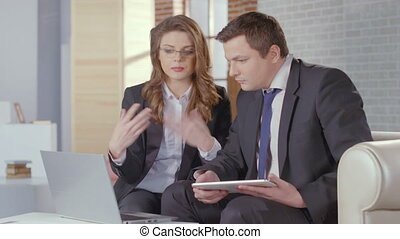 Woman assistant presenting report to chief, business meeting