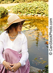 Woman at a pond with lilies