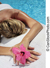 Woman at a Spa - Woman by a blue pool waiting for a a...