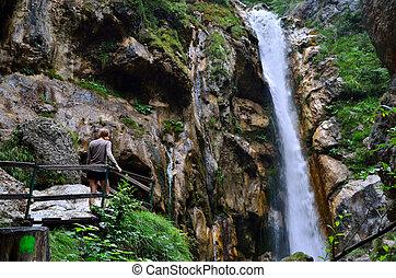 woman at a waterfall