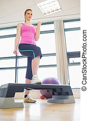 Woman at aerobics class in gym