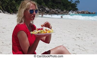 Woman at Anse Georgette - SLOW MOTION: tourist woman in red...