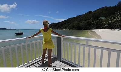 Woman at Anse Gouvernement - SLOW MOTION: Elegant tourist in...