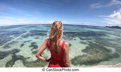 Woman at Anse Source d'Argent - Tourist woman on a granite...