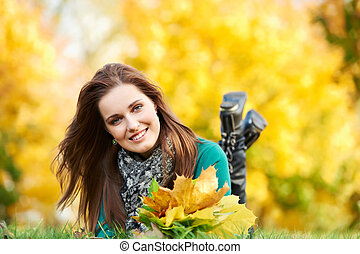 Woman at autumn outdoors