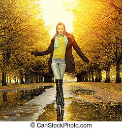 Woman at autumn