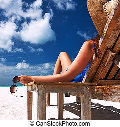 Woman at beach holding sunglasses - Woman at beautiful beach...