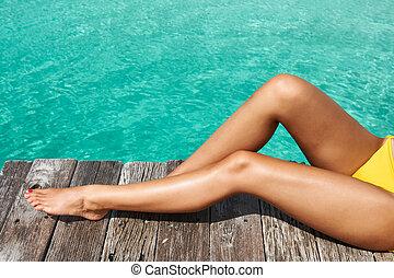 Woman at beach jetty