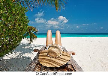 Woman at beach lying on chaise lounge - Woman at beautiful...