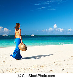 Woman at beach - Woman in skirt at tropical beach