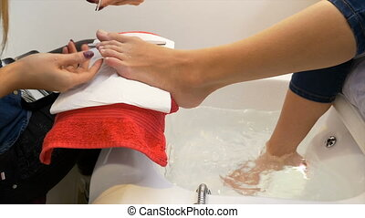 Woman at beauty parlor getting her pedicure done