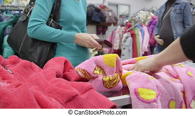 Woman at checkout of clothing store