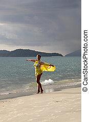 Woman at coast of the sea