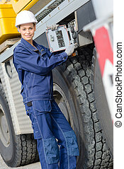 Woman at controls of heavy plant vehicle