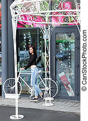 Woman at decorative bicycle