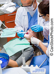 Woman at dentist surgery have teeth treatment