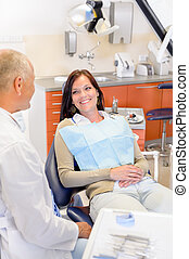 Woman at dentist surgery