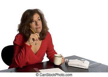 woman at desk thinking