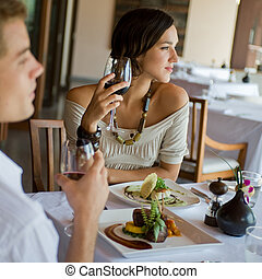 Woman At Dinner - A young couple having dinner at a ...