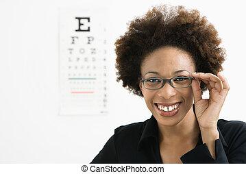 Woman at eye doctor