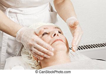 Woman at face massage