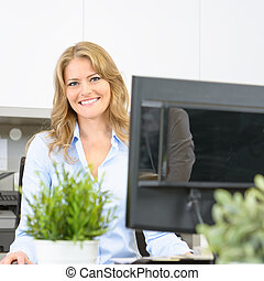 Woman at her desk