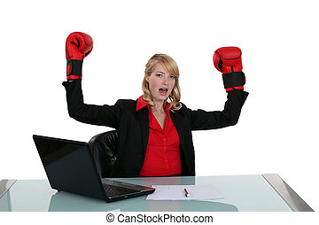 Woman at her desk with boxing gloves