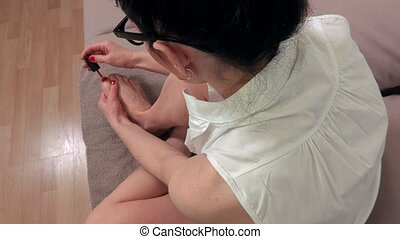 Woman at home doing pedicure