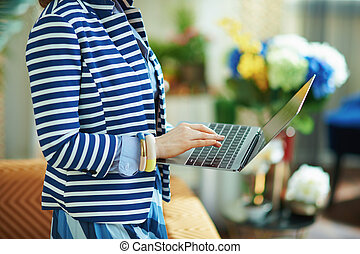 woman at home in sunny day using laptop
