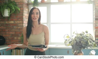 Woman at home - Lifestyle and recreation. Beautiful woman at...