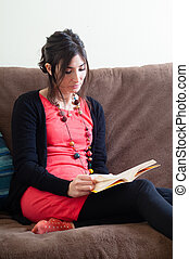woman at home reading book