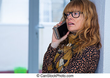 woman at home talking on mobile phone