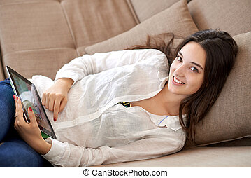 woman at home using tablet